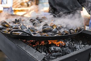 Fresh mussels at grill pan. Seafood