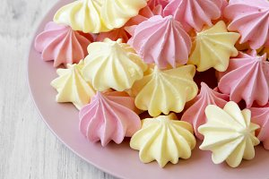 Mini meringues on pink plate