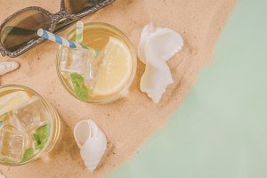 Summer concept - sand, drinks