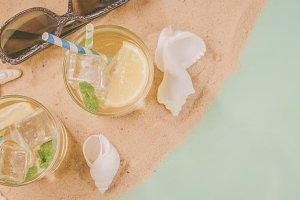 Summer concept - sand, drinks