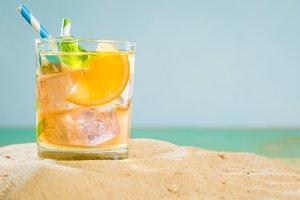 Summer drink on sand beach