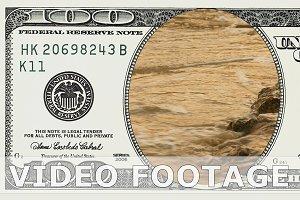 Sea waves sunset in 100 dollar bill