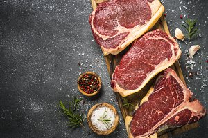Raw meat beef steak on black top