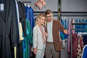 happy stylish young couple shopping