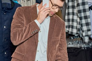 young man in eyeglasses talking by s