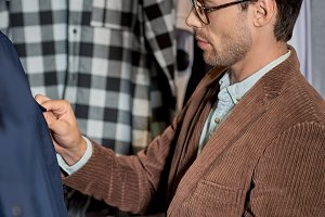 man in eyeglasses choosing clothes w