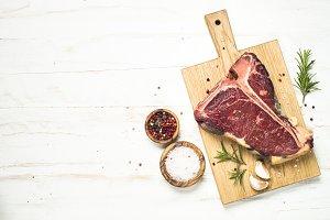 T-bone beef steak on white with