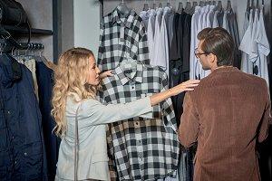 young couple choosing stylish clothe