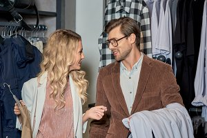 couple holding fashionable clothes a