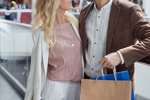 young couple holding shopping bags a