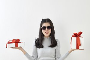 Young woman happy hold gift box in h