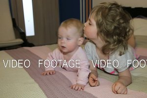 Child and her newborn sister on the