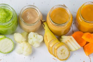 Colorful baby food purees in glass