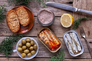 Cans of sardines, olives and foie