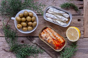 Cans of sardines, olives and lemon