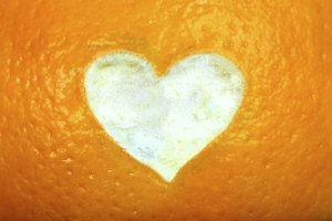 orange with heart carved