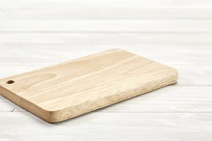 Cutting board top view on wooden bac