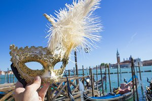 Venetian mask and gondolas in Venice