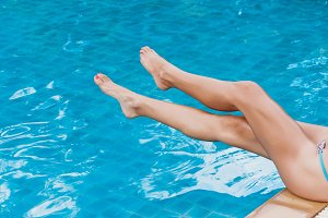 Woman relaxing at the water pool