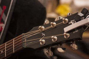 Detail of the headstock of a guitar.