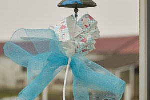 Blue bow hanging from a bell