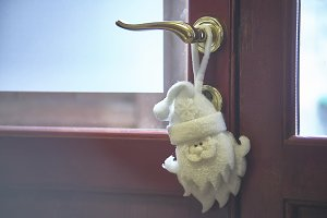 Santa Claus hanging on the door hand