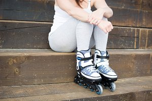 young woman with roller-skates