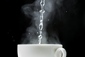 Pouring water in cup