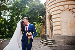 Wedding couple in love stay against