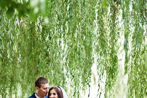 Wedding couple in love hugging at pa