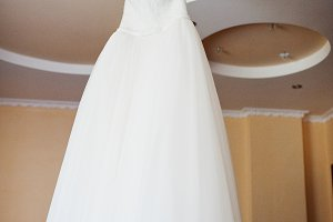 Wedding dress on hangers at ceilling