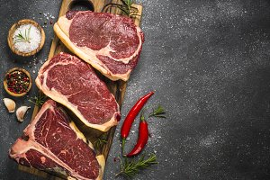 Raw meat beef steak on black top vie