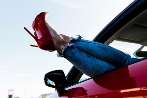 Image of woman's legs in red shoes