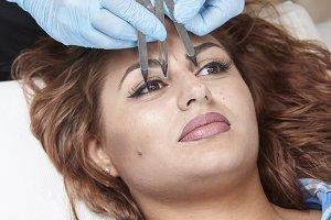 microblading, woman checking  eyebro