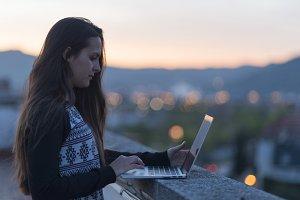 pretty brunette holding her computer