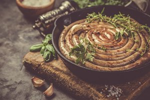 Barbeque sausages on cast iron pan