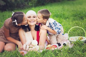 mother with kids having picnic