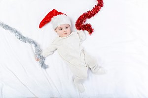 beautiful baby boy in christmas hat