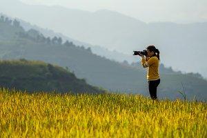 back side of photographer taking pho