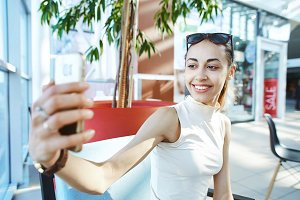 Young smiling woman making selfie in