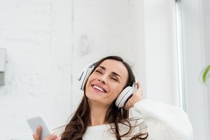 smiling young woman listening music