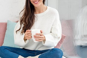 happy young woman with cup of coffee
