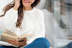 beautiful young woman reading book a