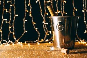 champagne bottle in bucket on garlan