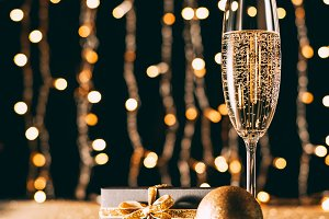glass of champagne, golden baubles a