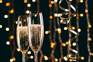 champagne in glasses and ribbons on