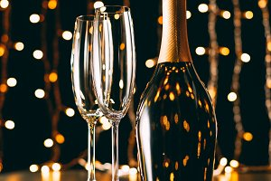 champagne bottle and glasses on garl