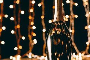 champagne bottle on garland light ba