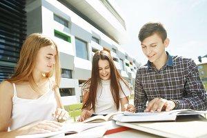 three happy high school students