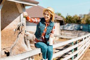 happy female farmer with milk bottle